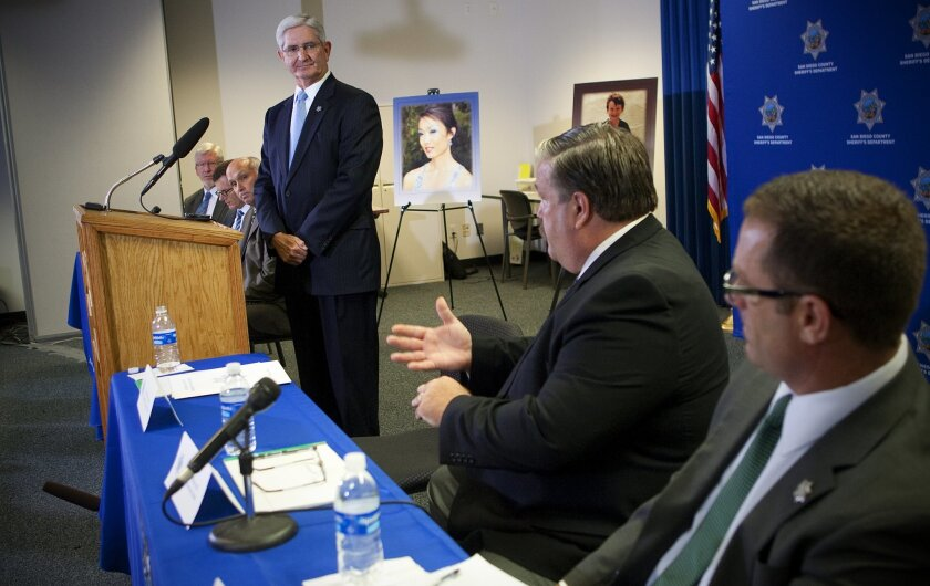 San Diego county Sheriff Bill Gore held a press conference to announce the findings into the investigation of the deaths of Max Shacknai and Rebecca Zahau.  Sheriff's Sgt. Dave Nemeth [middle] answered questions from news reporters.  Also pictured is sheriff's Capt. Tim Curran [right].