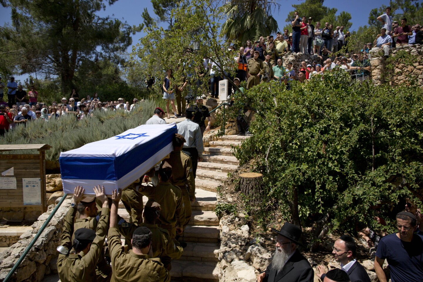 Israeli soldiers carry the coffin of Israel Defense Forces Sgt. Max Steinberg, an L.A. native, during his funeral Wednesday at the military cemetery in Jerusalem.