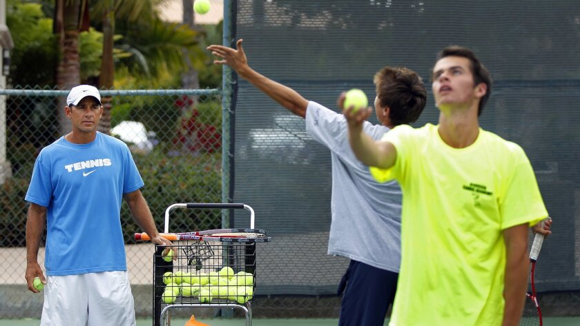 Ken Giavara (left) instructs Greg Lyon (center) and Jake Roberts at the Giavara Tennis Academy, which has produced numerous top junior and high school players.