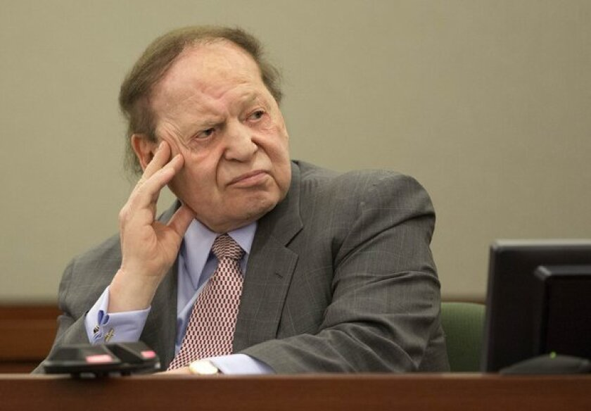 Las Vegas Sands Corp. CEO Sheldon Adelson testifies in a Las Vegas courtroom in April in a lawsuit filed by a former consultant. On Tuesday a jury awarded the consultant $70 million.