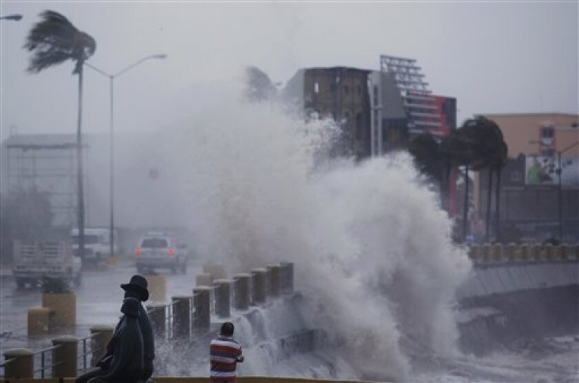 Waves crash against the sea wall as Tropical Storm Rick hits Mazatlan, Mexico, Wednesday, Oct. 21, 2009. Tropical Storm Rick weakened rapidly as it headed for Mexico's Pacific coast after sparing Baja California's resorts a direct blow.  (AP Photo/Guillermo Arias)