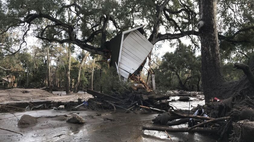 The debris flow hung this mostly intact garage into a tree along Montecito Creek.
