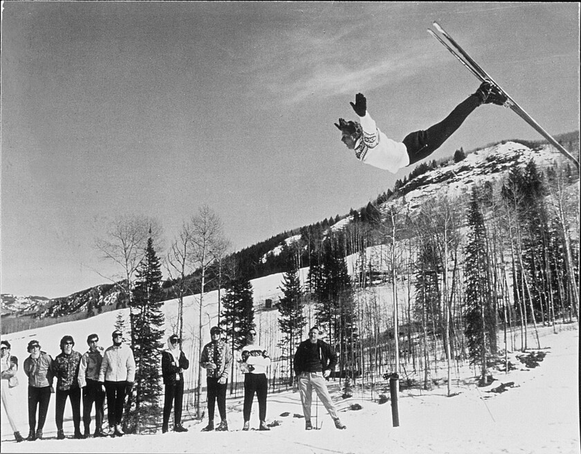 Norwegian skier Stein Eriksen, performing one of his signature layout flips.