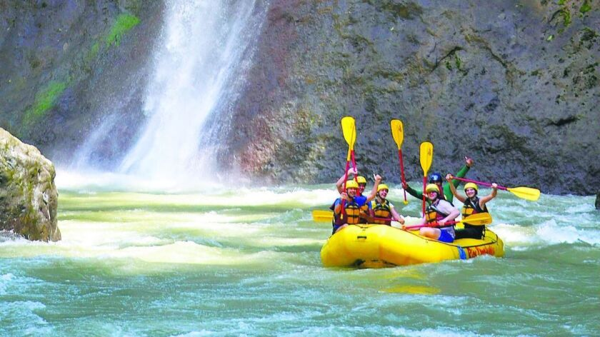 """After a particularly challenging set of rapids on Costa Rica's Pacuare River, paddlers raised their oars and shouted """"pura vida,"""" pure life."""