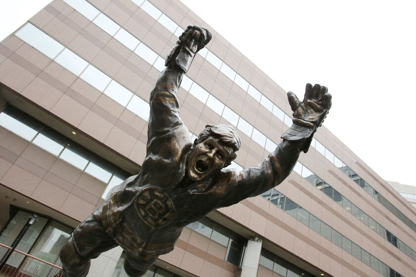 A statue of Bruins legend Bobby Orr is shown in front of TD Garden in Boston during the 2011 Stanley Cup playoffs.
