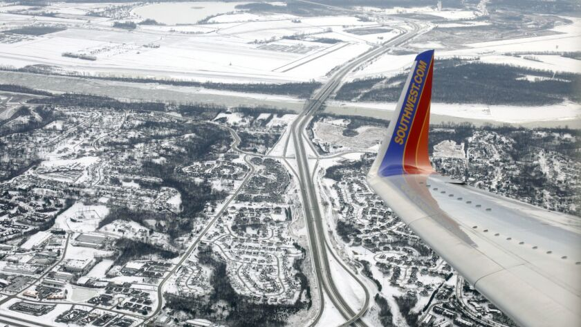FILE- In this Jan. 8, 2014, photo, file a Southwest Airlines plane approaches Lambert–St. Louis In