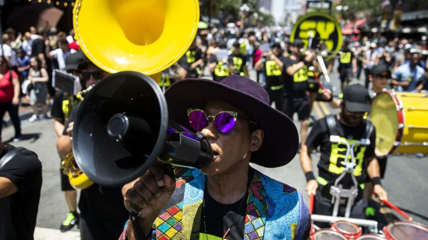 SAN DIEGO, CALIF. - JULY 19: Actor Orlando Jones leads SyFy Marching Band down 5th Avenue in the Gas