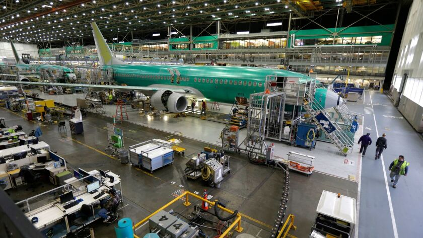 Boeing 737-800 airplanes are on the assembly line in Renton, Wash., in 2014