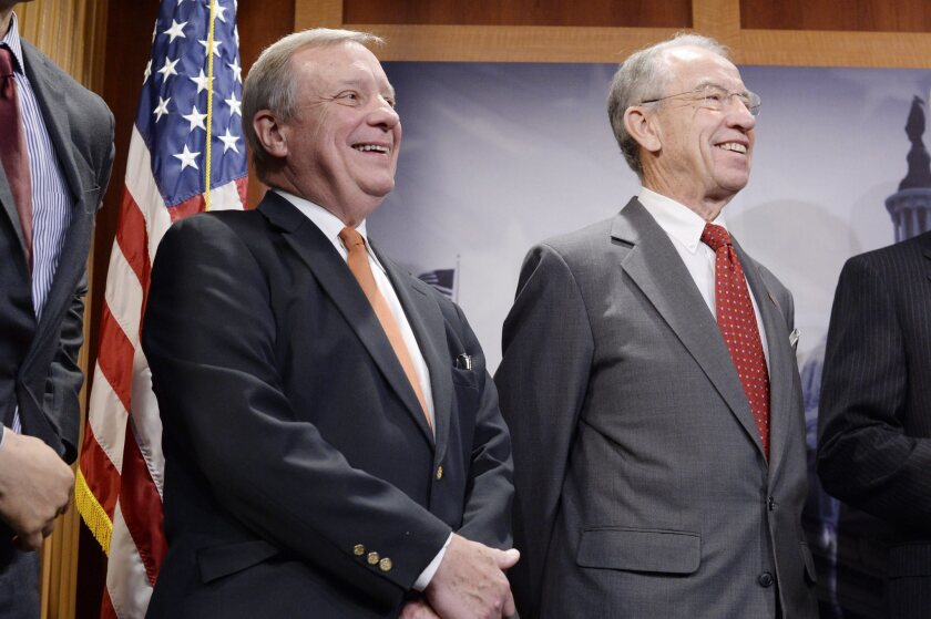 Democratic Senator Dick Durbin (left) and Republican Senator Chuck Grassley attend a news conference held to discuss the 'Sentencing Reform and Corrections Act of 2015' on Capitol Hill on Oct. 1.
