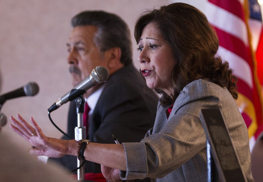 """Supervisor candidates Hilda Solis, right, and Juventino """"J"""" Gomez answer questions during a lunch forum in Pomona."""