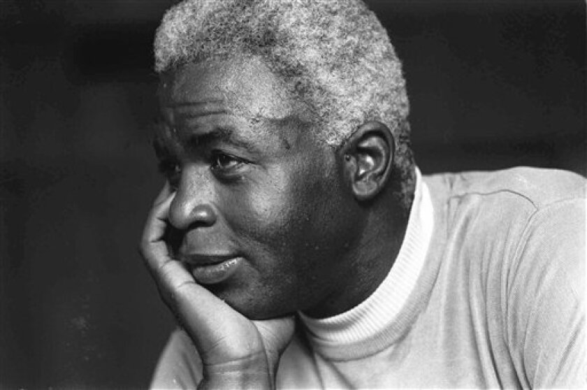 FILE - In this June 30, 1971 file photo,  Jackie Robinson poses at his home in Stamford, Conn. Kansas City's Negro Leagues Baseball Museum is hosting an advance screening of an upcoming movie about Robinson, who broke major league baseball's color barrier. Thomas Butch of the financial firm Waddell