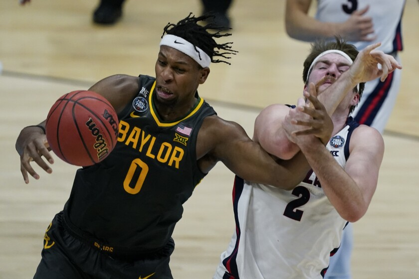 Flo Thamba of Baylor and Drew Timme of Gonzaga face off during an NCAA Men's basketball championship game