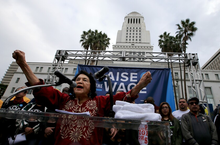 Labor leader Dolores Huerta speaks outside City Hall on Jan. 30 during a rally urging the City Council to raise Los Angeles' minimum wage.