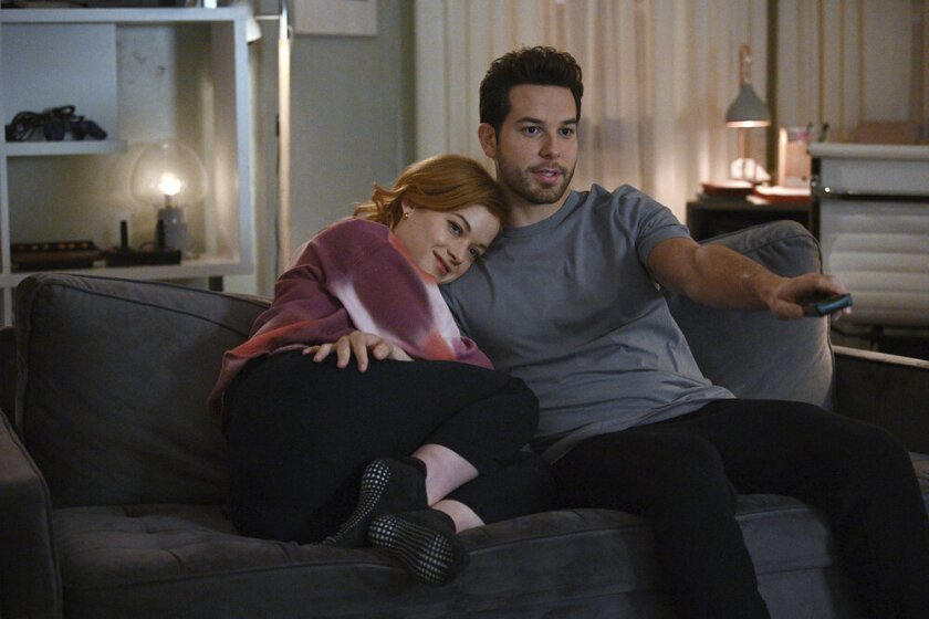 """This image released by NBC shows Jane Levy, left, and Skylar Astin in a scene from """"Zoey's Extraordinary Playlist."""" Season two of the musical series airs Tuesdays on NBC. (Sergei Bachlakov/NBC via AP)"""