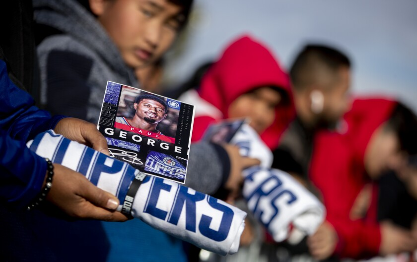 """Fans await the arrival of Clippers forward Paul George on """"Paul George Day"""" at Domenic Massari Park in Palmdale on Sunday."""