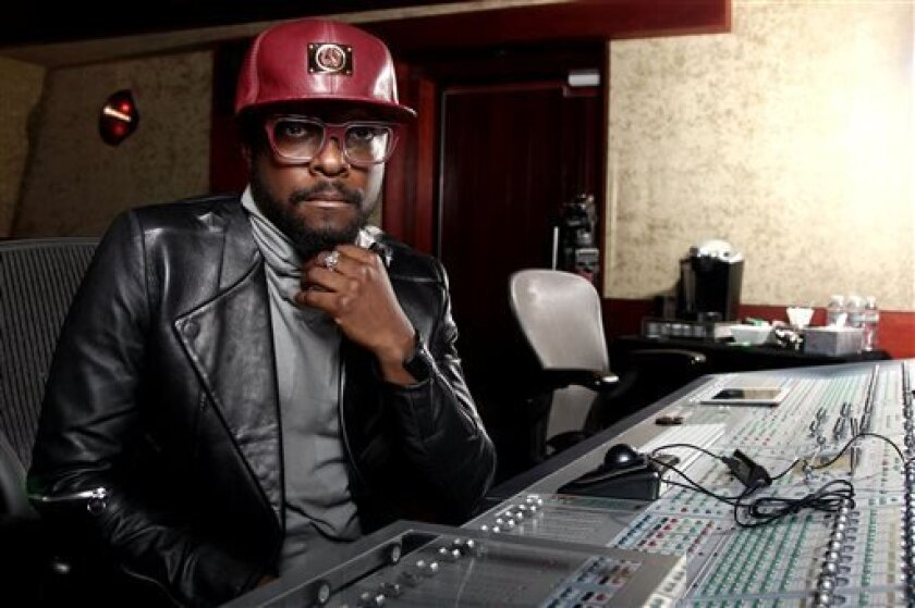 "In this April 24, 2013 photo, will.i.am poses for a portrait in Los Angeles. Will.i.am says he's been unfairly accused of stealing a song from a Russian dance producer. The producer-rapper-singer has acknowledged reaching out to trance producer Arty after hearing his 2011 song with London's Mat Zo, ""Rebound."" Will.i.am recorded a new version with Chris Brown titled ""Let's Go."" Will.i.am credits Arty as a writer on the song in the liner notes for his album, ""#willpower,"" released this week. He"