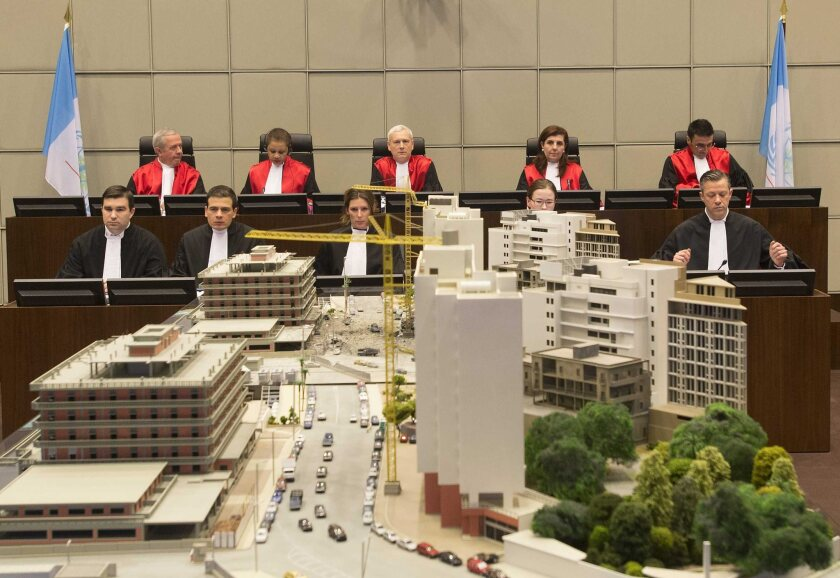 Judges of the Special Tribunal for Lebanon in The Hague, Netherlands, preside over the opening of the trial in absentia of four suspects in the 2005 killing of former Lebanese Prime Minister Rafik Hariri and 21 others. An architectural mockup of downtown Beirut has been prepared for the first trial of terrorism charges at an international court.
