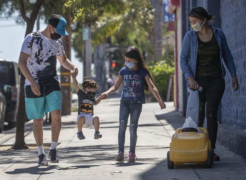 A family goes for a walk in Boyle Heights
