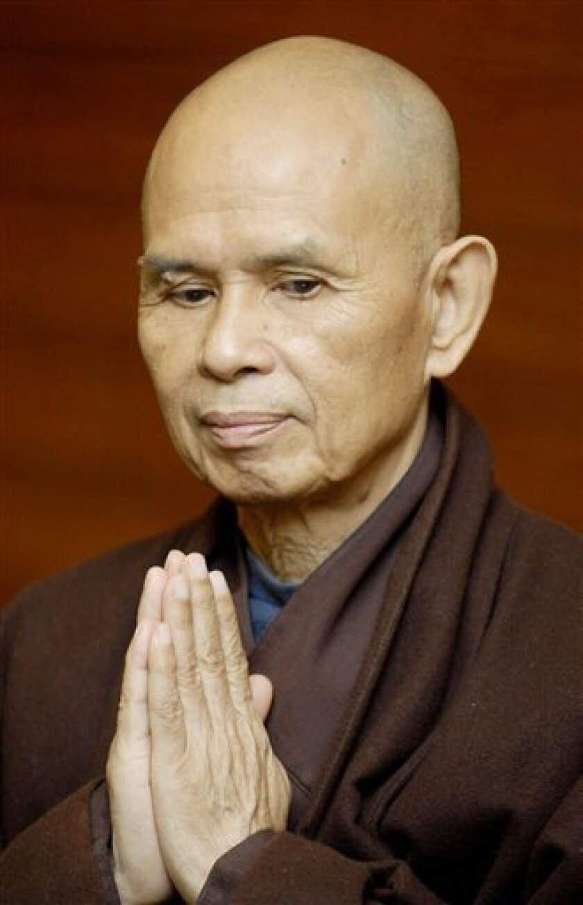 FILE - In this May 20, 2007 file photo, Vietnamese monk Thich Nhat Hanh is seen upon his arrival at Suvarnabhumi international airport in Bangkok. Some 400 disciples of Nhat Hanh, who has popularized Buddhism in the West and sold millions of books worldwide, were forcibly evicted from the Bat Nha monastery in Lam Dong province in late September, 2009. Since then, nearly 200 have taken refuge at the nearby Phuoc Hue pagoda, but they have been ordered to leave by Dec. 31. (AP Photo/File)