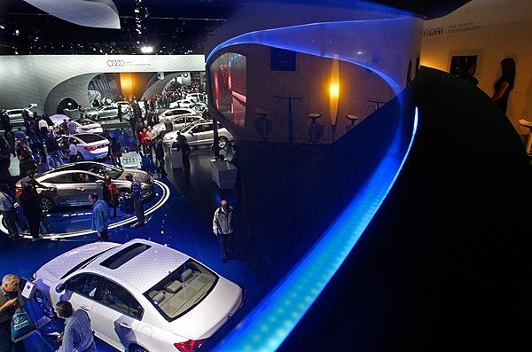 Visitors check out Hyundai and Audi automobiles at the L.A. Auto Show. It opened to the public at the Los Angeles Convention Center today. It will be open Thanksgiving day.