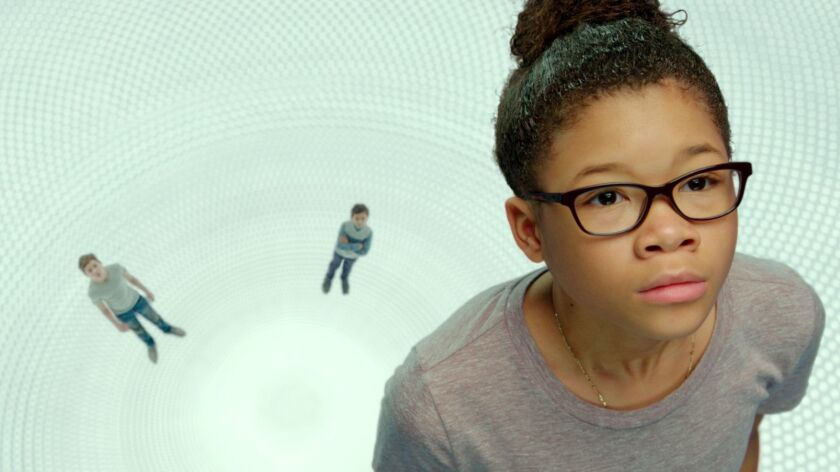 This image released by Disney shows Storm Reid, from left, Deric McCabe and Reese Witherspoon in a s