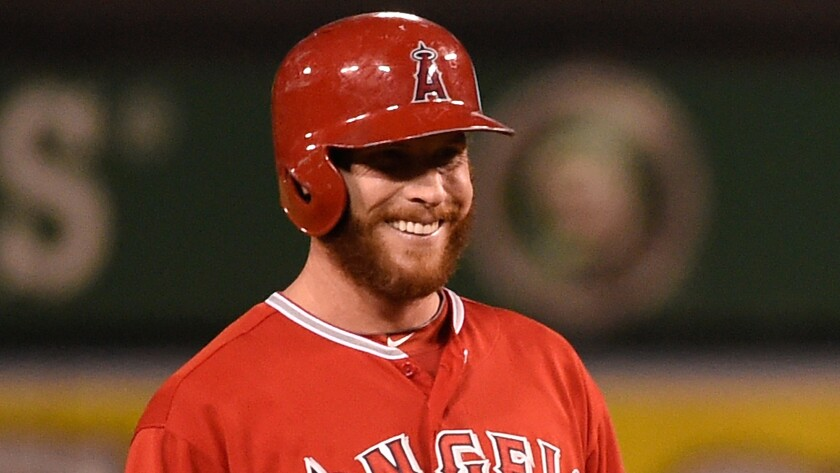 Angels outfielder Josh Hamilton smiles while standing at second base during a game against the Oakland Athletics on Aug. 28.