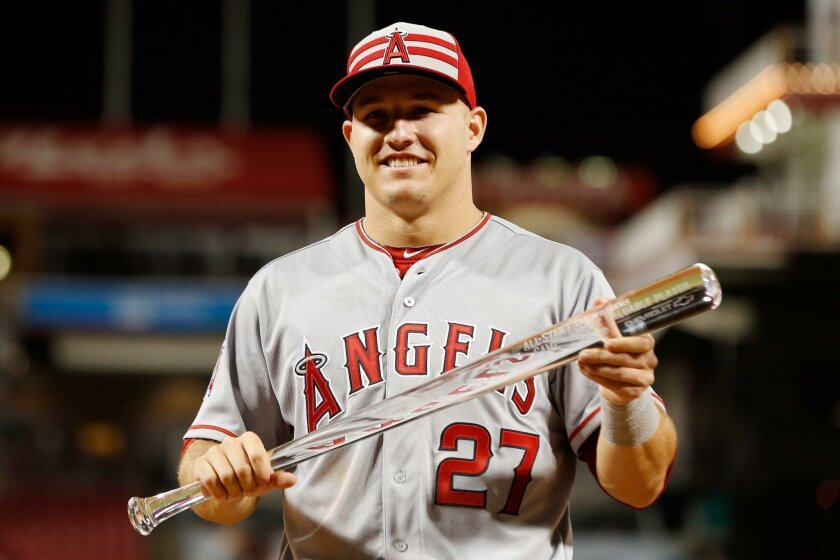 Mike Trout poses with the MVP trophy last year after the All-Star game at Great American Ball Park.