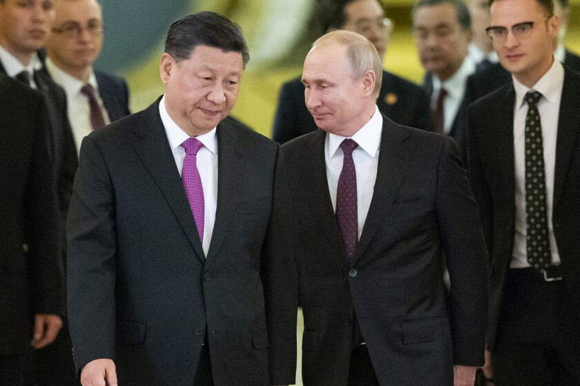 """FILE - In this June 5, 2019, file photo, Russian President Vladimir Putin, center right, and Chinese President Xi Jinping, center left, enter a hall for talks in the Kremlin in Moscow, Russia. Putin and Xi have developed strong personal ties helping bolster a """"strategic partnership"""" between the two former Communist rivals. (AP Photo/Alexander Zemlianichenko, Pool, File)"""