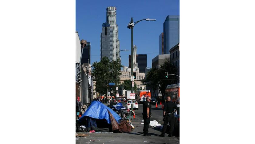 Skid row is in the shadow of downtown's skyscrapers.