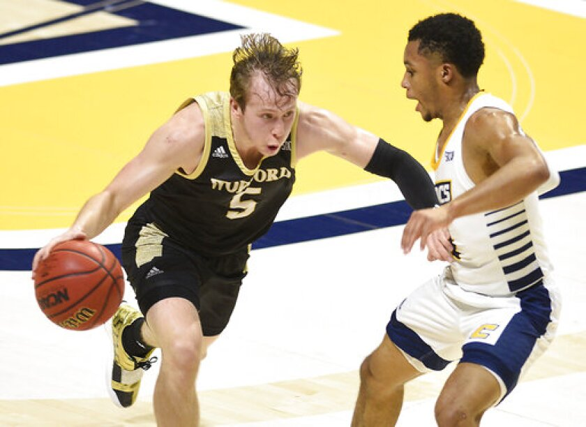 Wofford's Storm Murphy (5) drives as Chattanooga's Maurice Commander defends during an NCAA college basketball game Wednesday, Jan. 15, 2020, in Chattanooga, Tenn. (Robin Rudd/Chattanooga Times Free Press via AP)