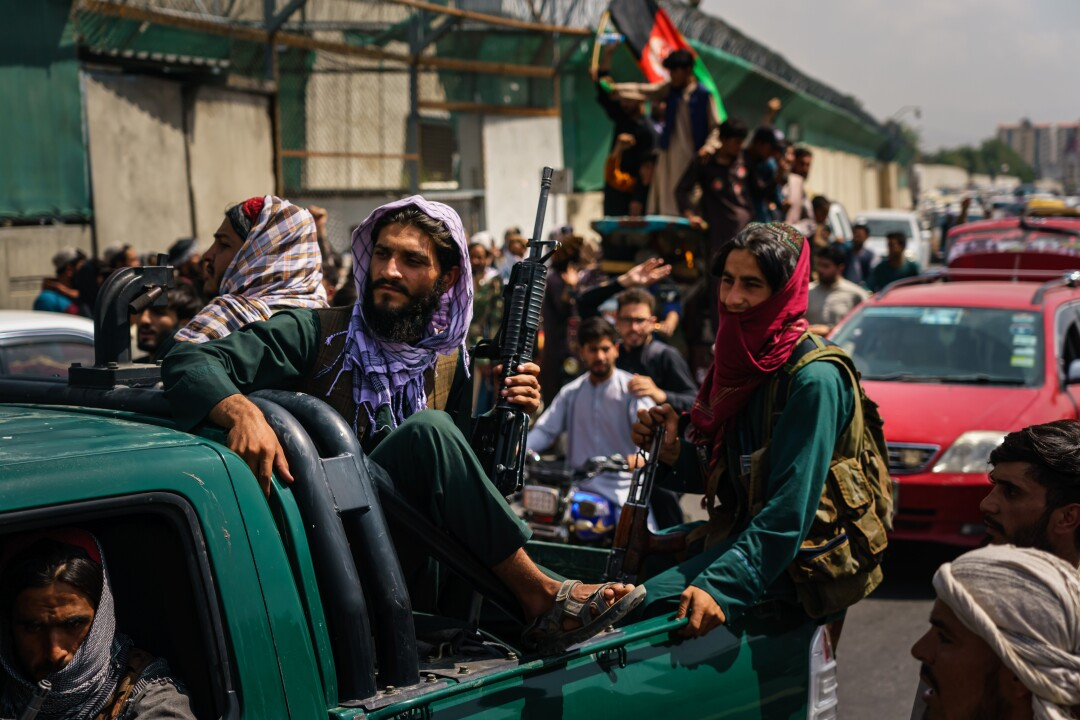Armed Afghans in a truck in Kabul, Afghanistan.
