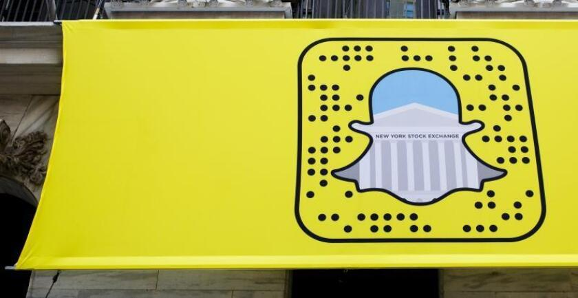 A logo for Snapchat hangs on the front of the New York Stock Exchange in New York, New York, USA. EPA/Justin Lane/File