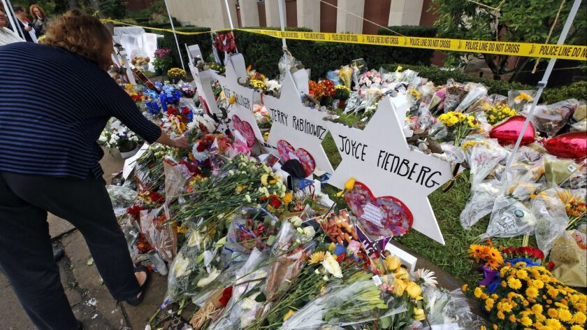 Flowers are placed Thursday, Nov. 1, 2018, at a makeshift memorial outside the Tree of Life Synagogu