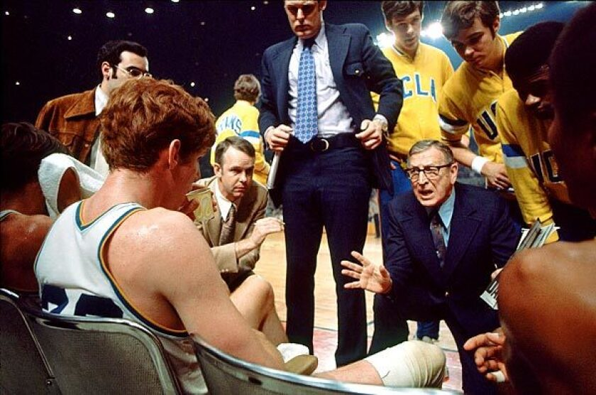 John Wooden instructs his players, including Bill , seated left, during the 1972 NCAA final at the Sports Arena in Los Angeles.