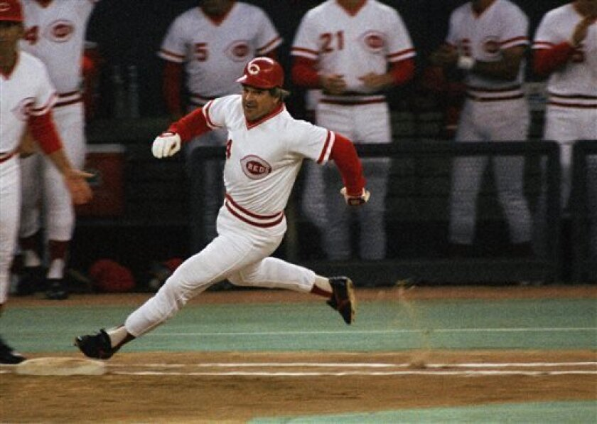 FILE - In this Sept. 11, 1985, file photo, Cincinnati Reds' Pete Rose rounds first base after hitting a single to break Ty Cobbs hitting record during a baseball game at Riverfront Stadium, Cincinnati, Ohio. The last player to be banned for life from baseball makes his living these days signing autographs. Rose has some advice for Alex Rodriguez if he wants to avoid the same fate. (AP Photo/File)