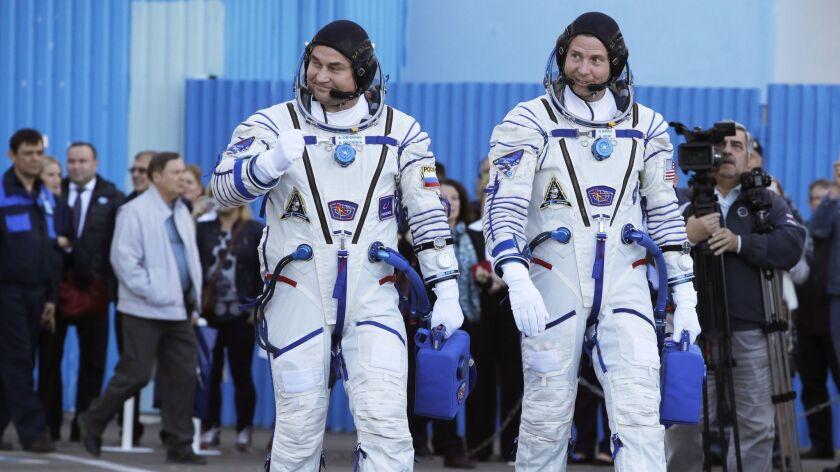 U.S. astronaut Nick Hague, right and Russian cosmonaut Alexey Ovchinin, member of the main crew of t