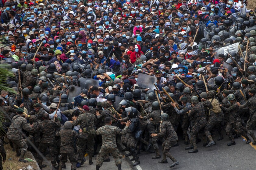 Honduran migrants clash with Guatemalan soldiers in Vado Hondo, Guatemala, on Sunday.