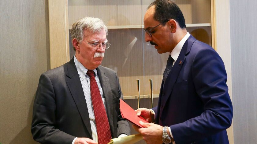 Turkish presidential spokesman Ibrahim Kalin, right, speaks with U.S. national security advisor John Bolton following their meeting Jan. 8 in the capital, Ankara.