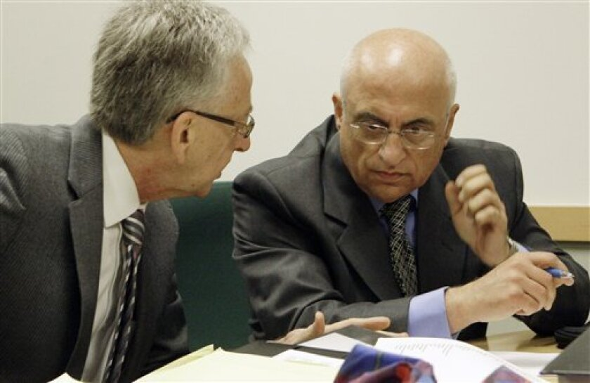 """Fertility specialist Dr. Michael Kamrava, right, and his attorney Henry R. Fenton prepare for a hearing before the California Board of Medical Examiners on possible suspension or revocation of his medical license, in Los Angeles Monday, Oct. 18, 2010. He is accused of """"grossly negligent'' treatment of `""""Octomom'' Nadya Suleman and another patient. (AP Photo/Reed Saxon)"""