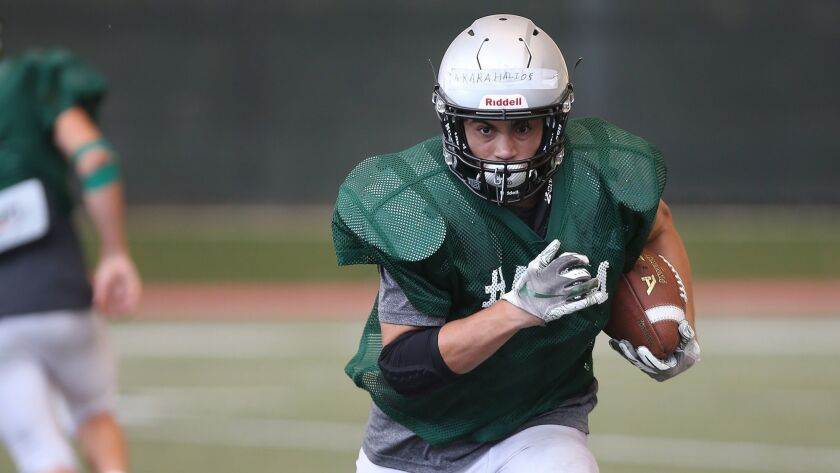 Running back Nick Karahalios follows blockers in practice as Sage Hill looks forward to upcoming sea