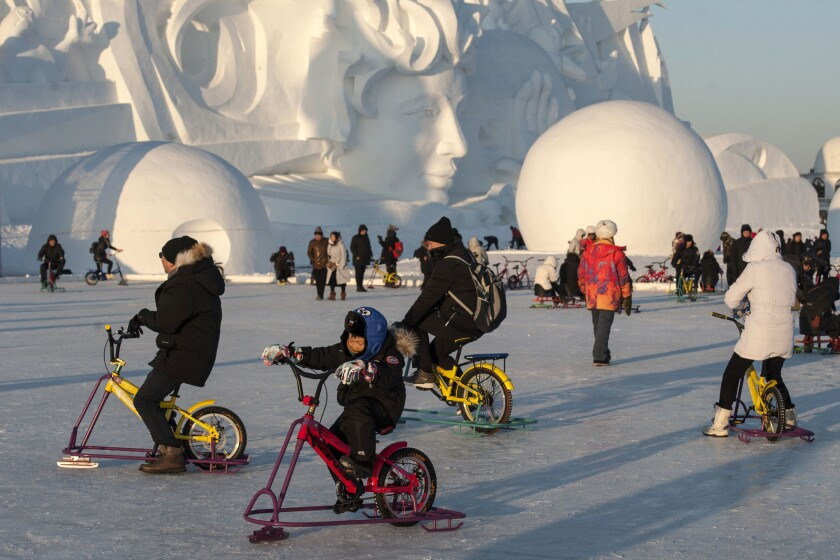 Tourists visit the Harbin International Snow Sculpture Art Expo at Harbin Sun Island park in Harbin, China.