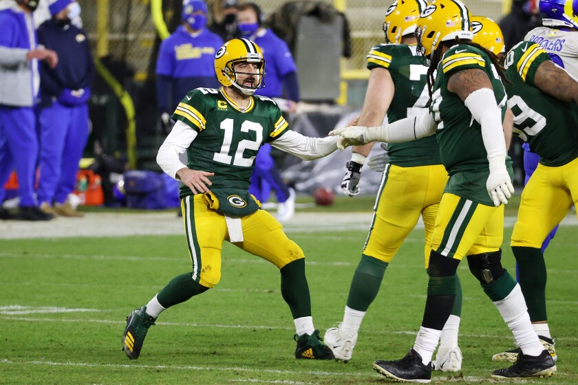 Aaron Rodgers of the Green Bay Packers celebrates throwing a touchdown pass in fourth quarter.