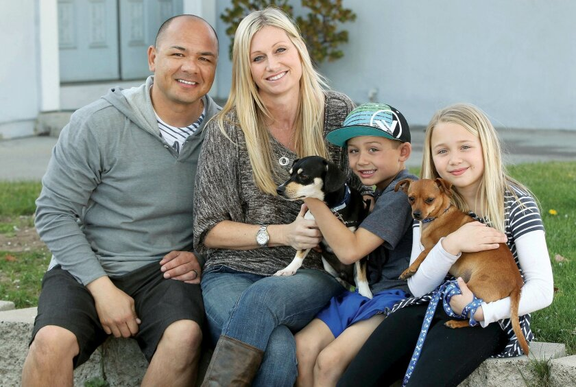 The Line family -- (from left) Ray, Jennifer, Tyson and Payton -- with their two adopted dogs.