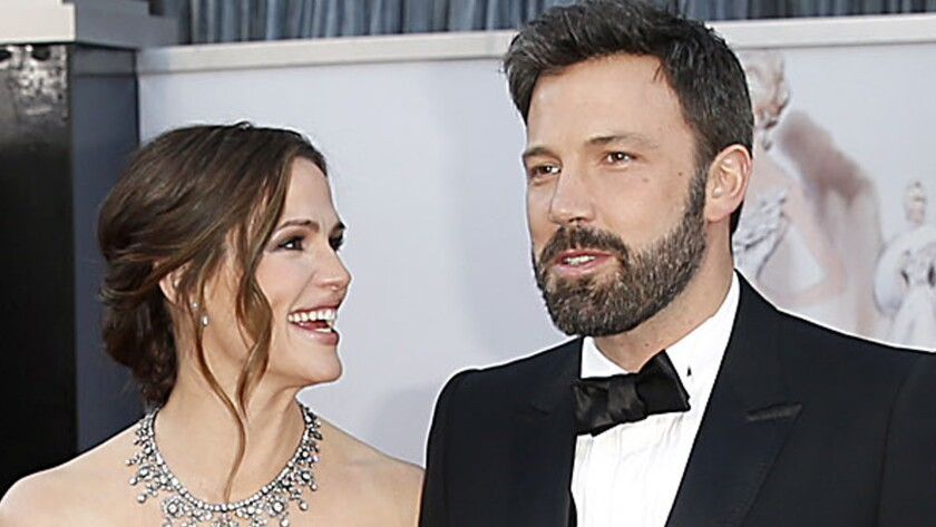 Jennifer Garner and Ben Affleck, shown together at the Oscars in 2013, announced Tuesday that they are getting a divorce