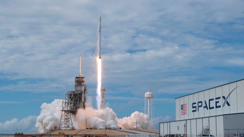 This image provided by NASA shows the SpaceX Falcon 9 rocket, with the Dragon spacecraft onboard, la
