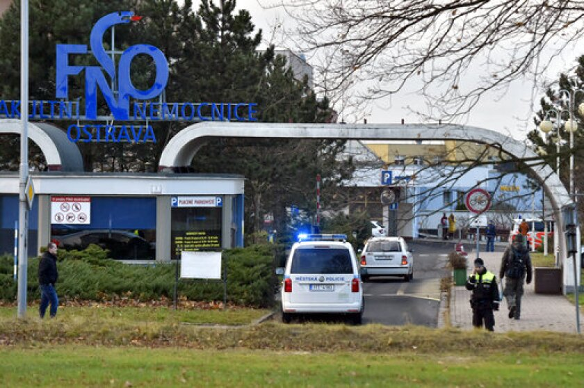 Police arrive at a hospital in Ostava, Czech Republic, after a shooting Dec. 10.