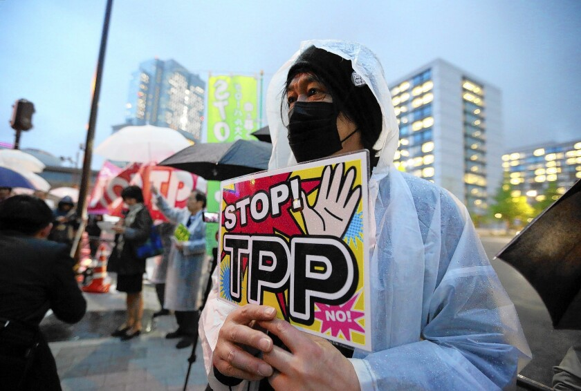 A man takes part in a Tokyo protest against Trans-Pacific Partnership trade talks ahead of President Obama's visit to Japan.