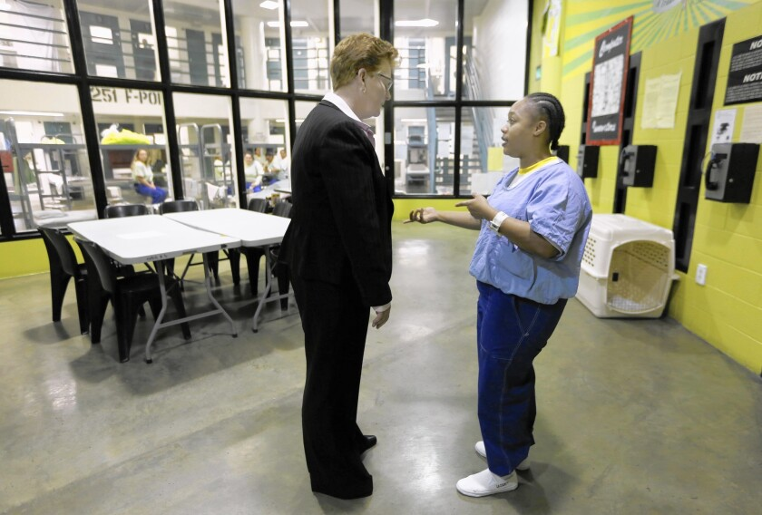 Assistant Sheriff Terri McDonald, who is stepping down after three years of overseeing L.A. County's jails, chats with inmate Pracille Harrell at the Twin Towers Correctional Facility.