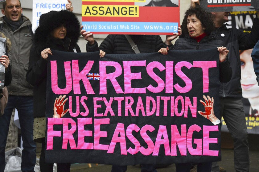 Supporters of WikiLeaks founder Julian Assange demonstrate outside Westminster Magistrates' Court in London on Monday.