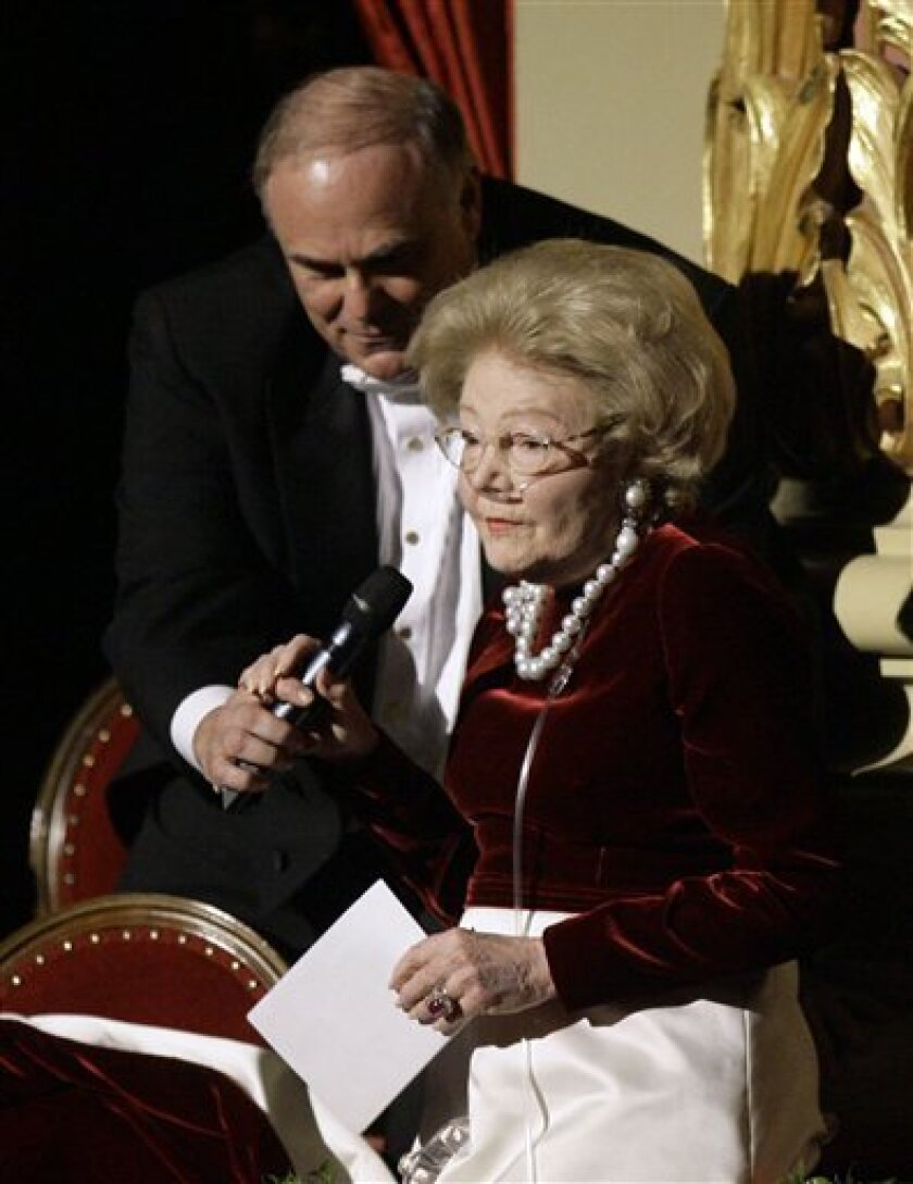 In this Jan. 27, 2007 file photo, Gov. Ed Rendell helps Leonore Annenberg with a microphone as she makes remarks at the Academy of Music in Philadelphia.  Annenberg, the philanthropist and wife of late publisher and ambassador Walter Annenberg, died early Thursday March 12, 2009, at Eisenhower Med